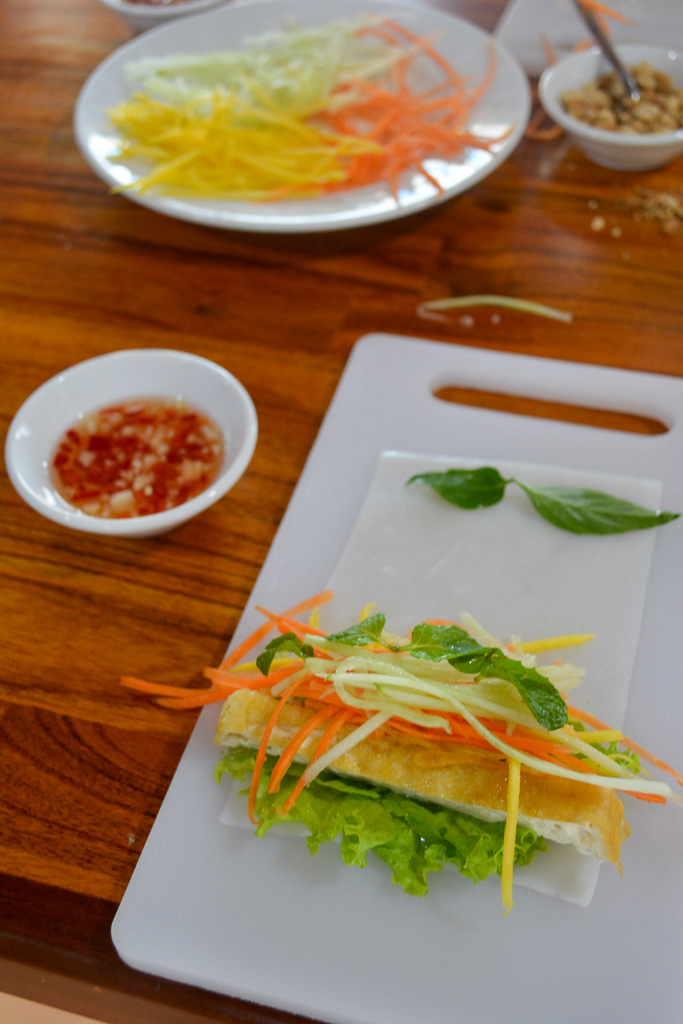 Rolling spring rolls at Hoi An Cooking School in Vietname