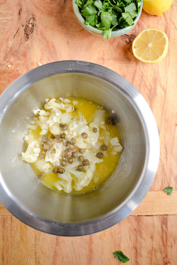 Boiled cauliflower with garlic butter, lemon juice, and capers