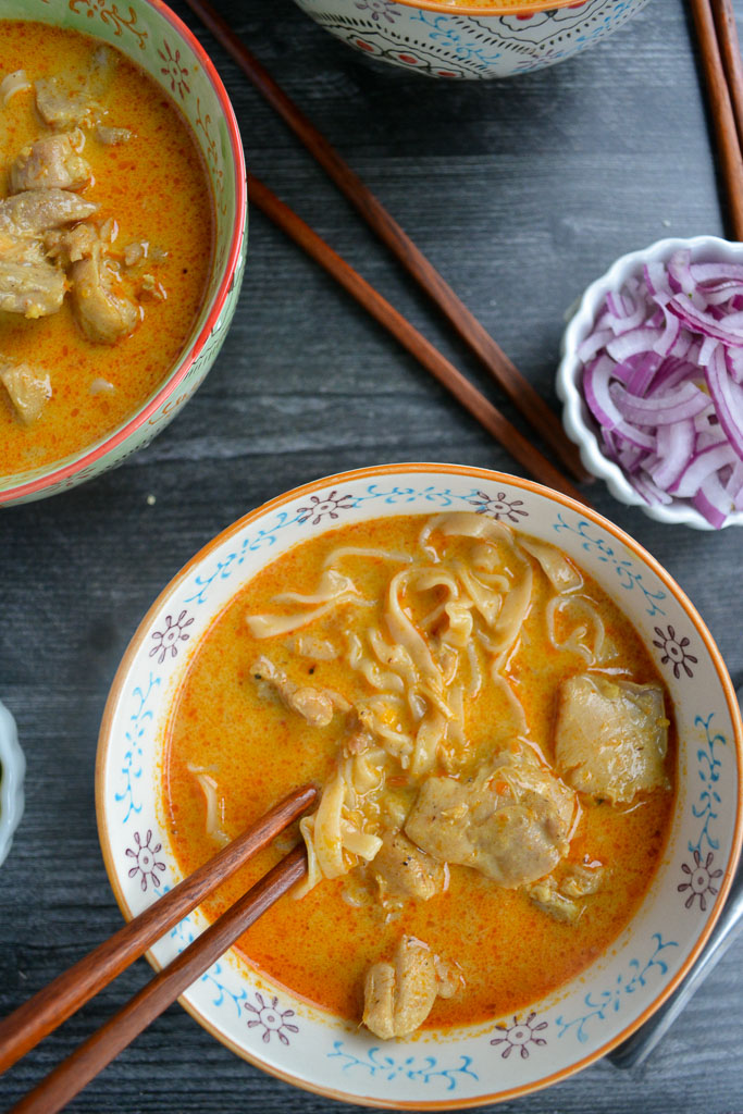 Egg noodles and chicken thighs in rich Khao Soi broth