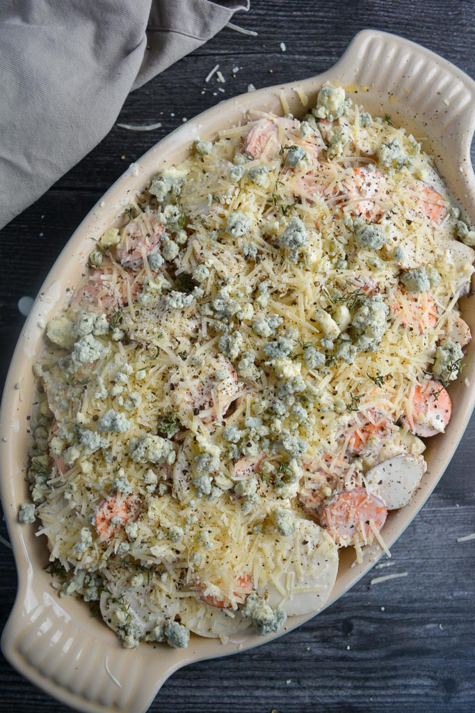Root vegetable gratin topped with parmesan and blue cheese