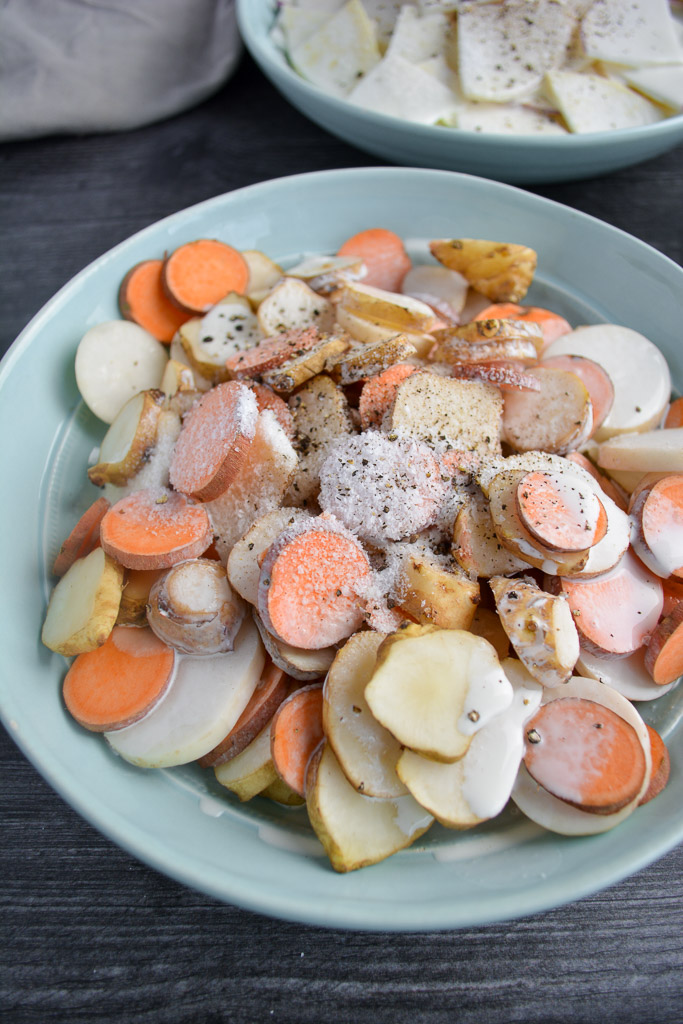 Sliced fingerling sweet potatoes, turnips, and sunchokes mixed with heavy cream and topped with salt and pepper
