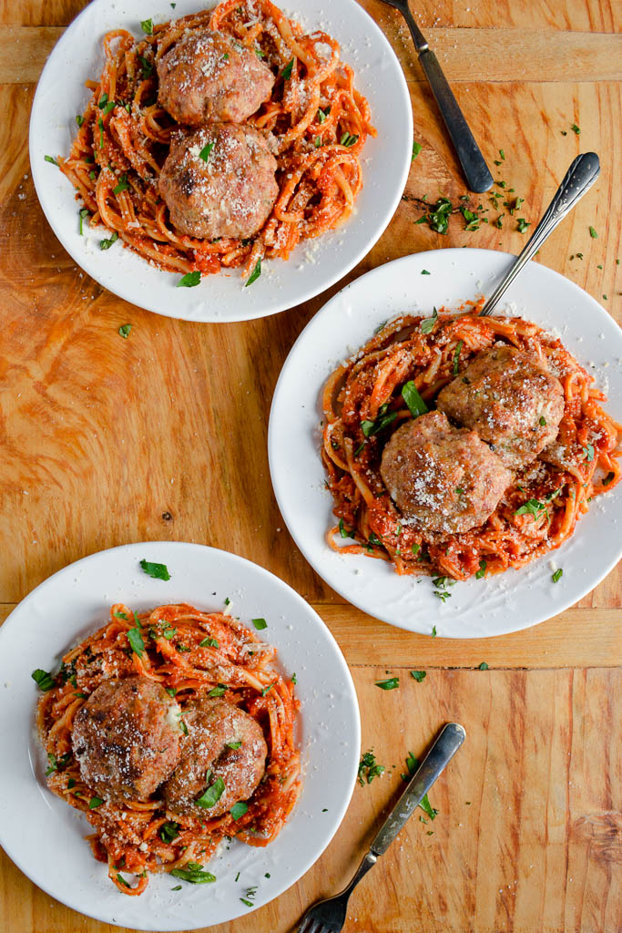 Southern Italian Stuffed Meatballs with Smoked Mozzarella and Spicy Salami with Red Pasta and Fresh Parmesan Cheese