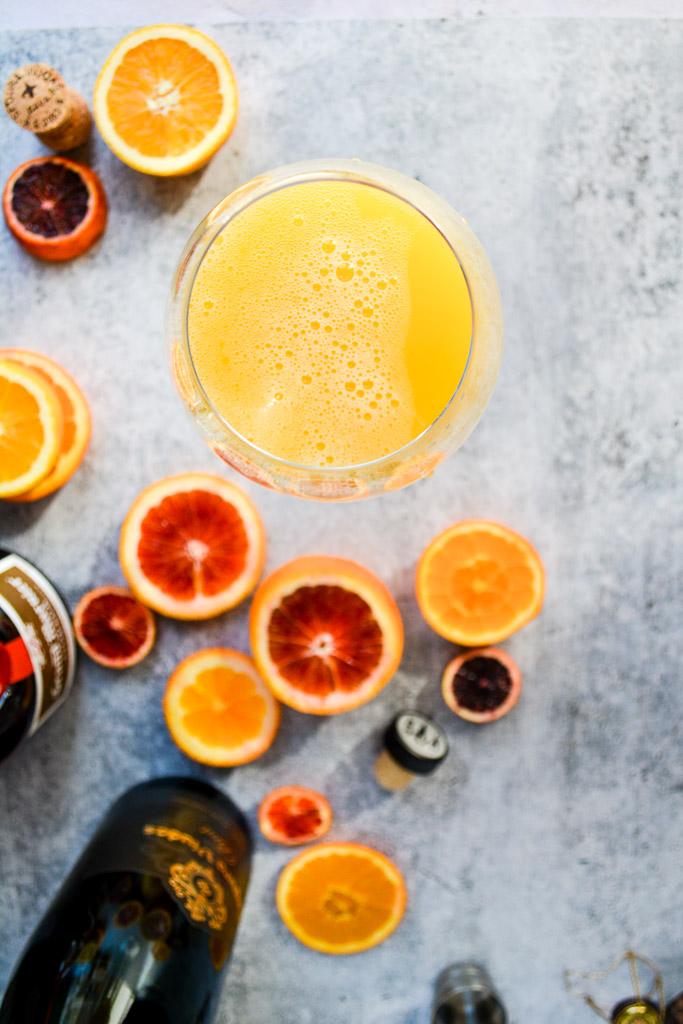 Agua de Valencia with navel oranges, blood oranges, and cara cara oranges