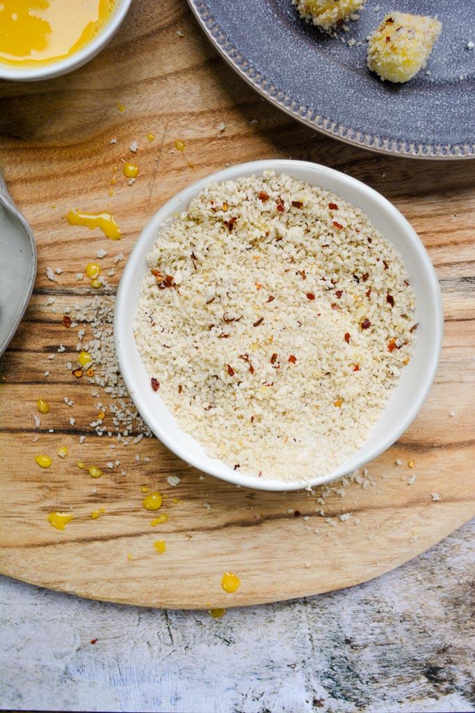 Seasoned panko breadcrumbs with egg wash drips