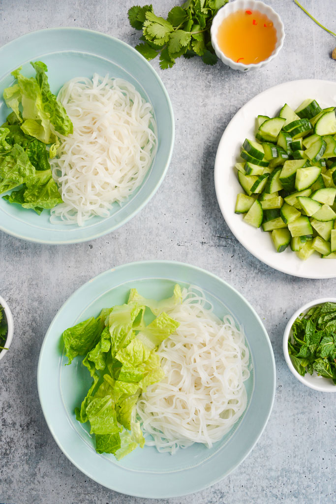 Bowls of cold rice noodles and romaine lettuce