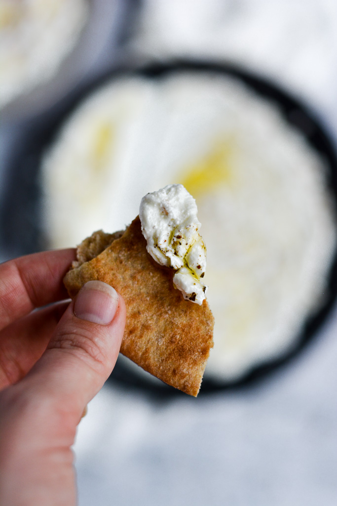 Pita wedge dipped in homemade labneh