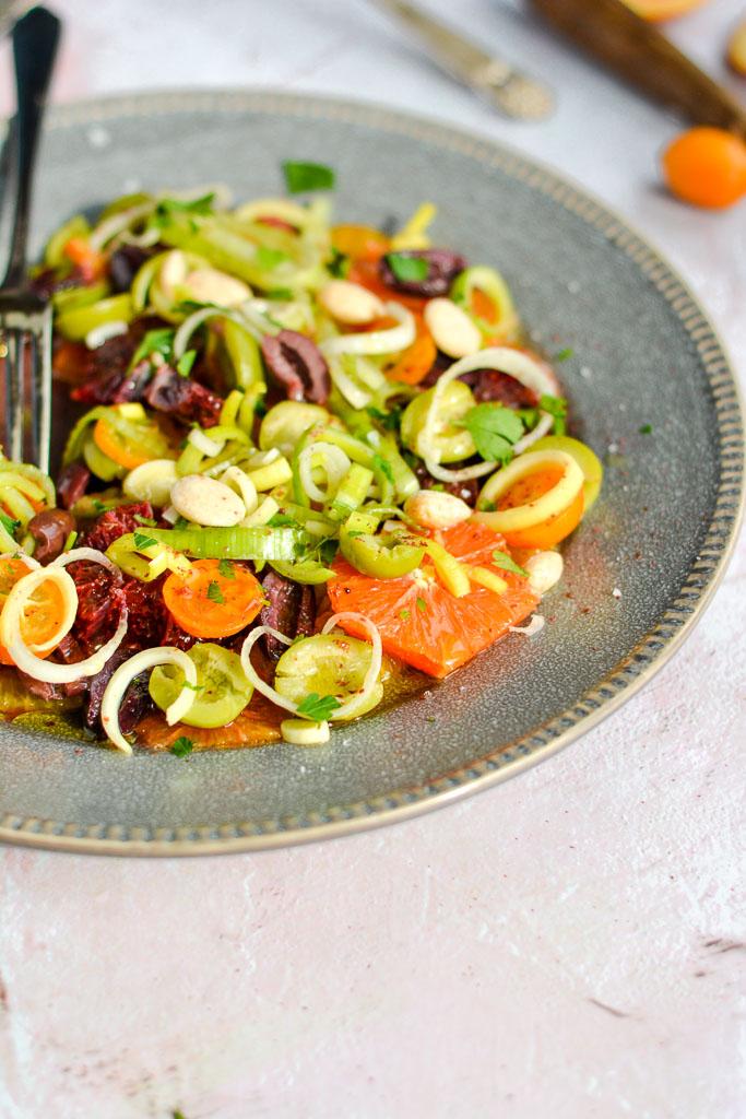 Spanish Orange & Olive Salad with Cara cara oranges, blood oranges, navel oranges, and kumquats with castelvetrana olives, softened leeks, and marcona almonds