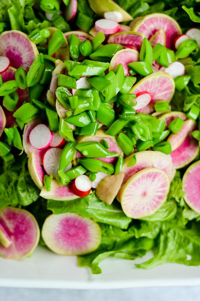 Salad greens, watermelon radishes, French breakfast radishes, and sugar snap peas