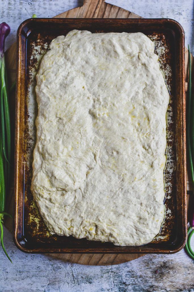 Shaping focaccia dough