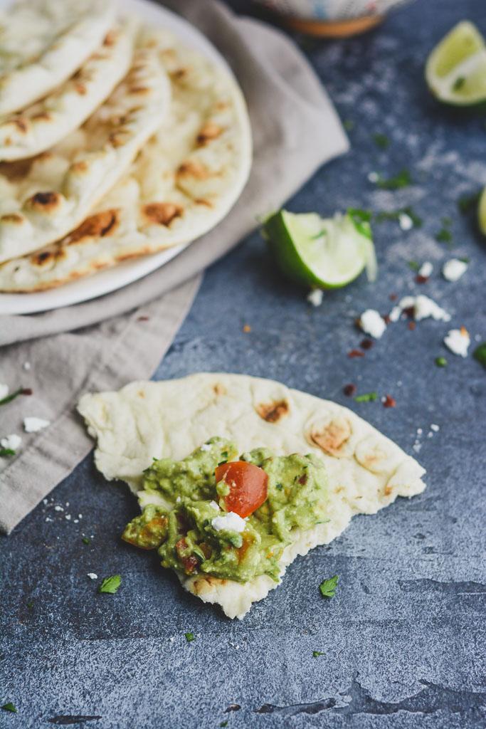 Pita Bread Dipped in Mediterranean Avocado Dip