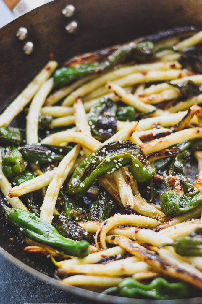 Shishito peppers and white green beans in a wok