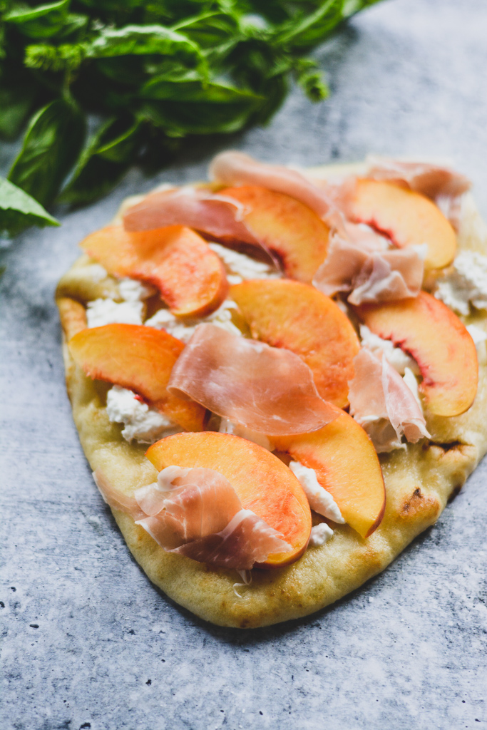 Pizza Crust with Olive Oil, Burrata, Sliced Peaches, and Prosciutto