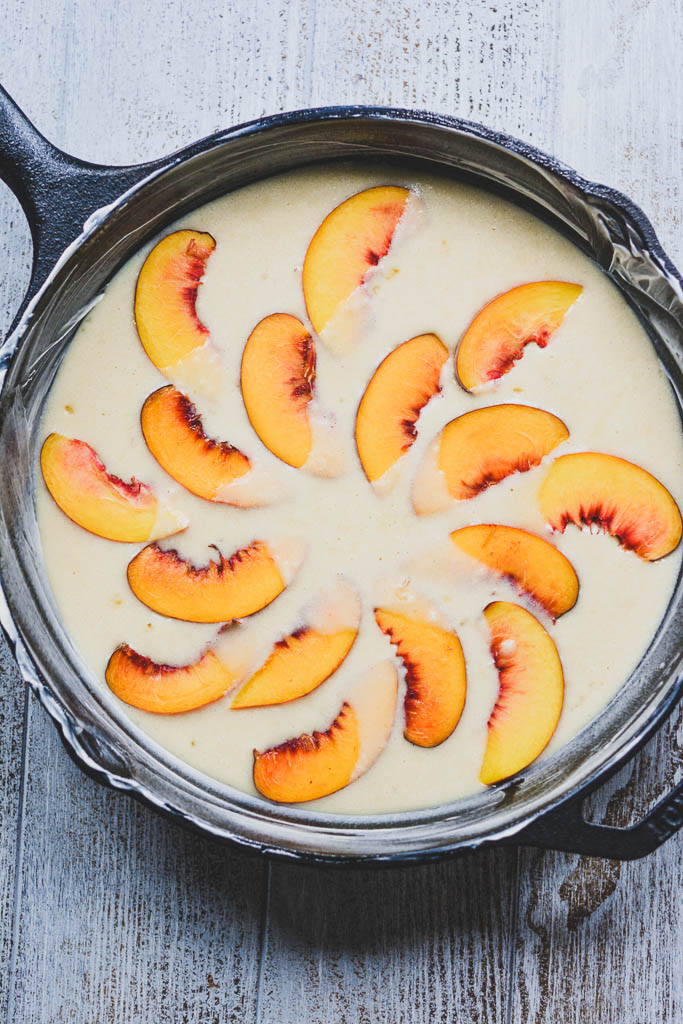 Peaches arranged in batter