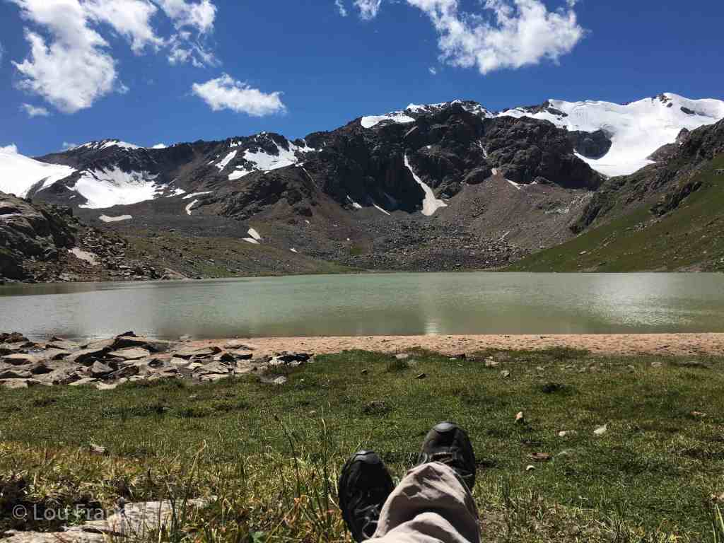 Putting my feet up next to a lake on a recent trip to Kyrgyzstan