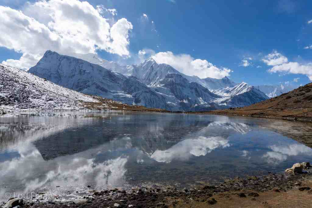 Annapurna circuit trek reflections in lower ice lake Manang