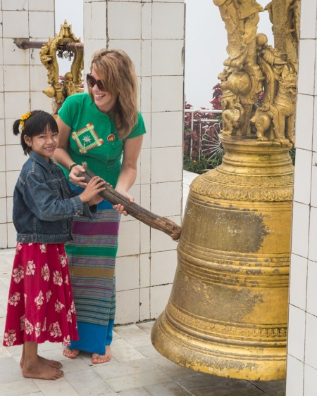 Ringing Prayer Bells at Kyaiktiyo Pagoda, Myanmar by Wandering Wheatleys