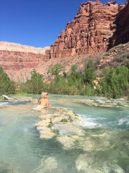 Soaking at the top of Navajo Falls, Arizona by Wandering Wheatleys