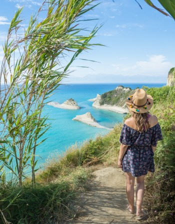 Girl looking at views of Cape Drastis on Corfu Island