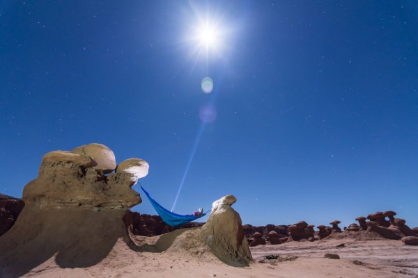 Hammock in Goblin Valley under the full moon (Utah, USA)