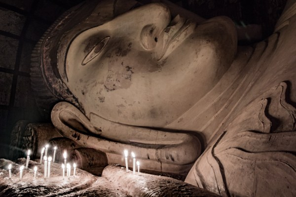 Buddha by Candle Light in Bagan, Myanmar by Wandering Wheatleys