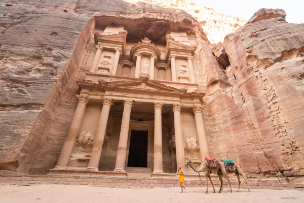 Leading camels at the Treasury, Petra, Jordan by Wandering Wheatleys