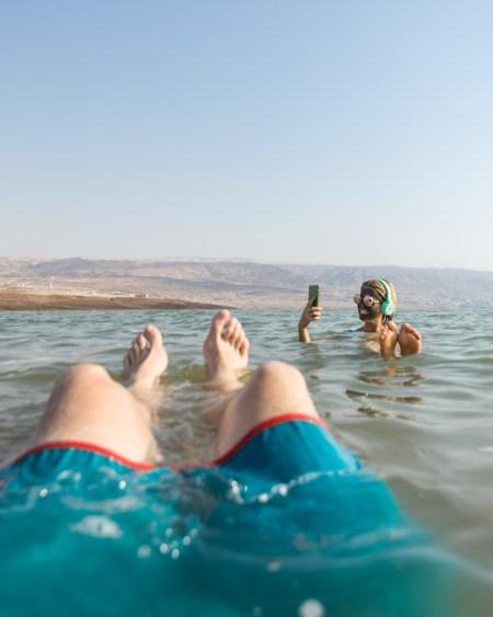 Floating in the Dead Sea, Jordan by Wandering Wheatleys