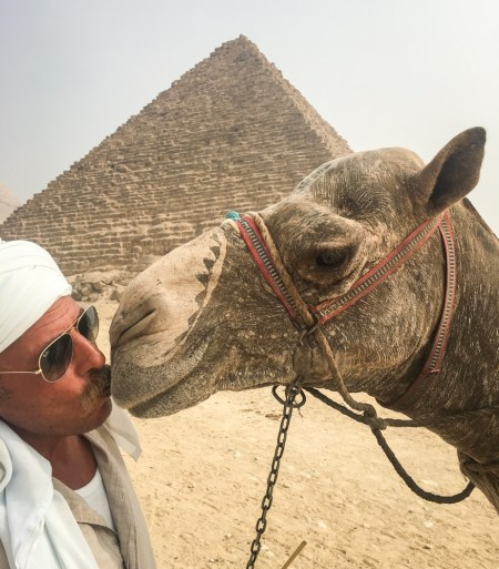 Camel owner Pyramids, Gaza, Egypt by Wandering Wheatleys