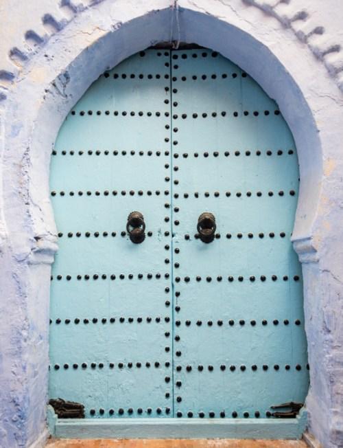 Blue Door in Chefchaouen, Morocco by Wandering Wheatleys