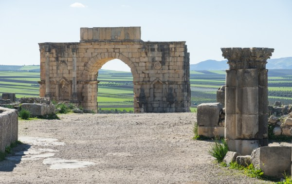 Triumphal Arch at Volubilis, Morocco by Wandering Wheatleys