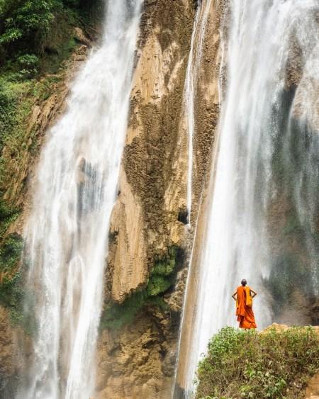 A monk at Dat Taw Gyaint Waterfall, Myanmar