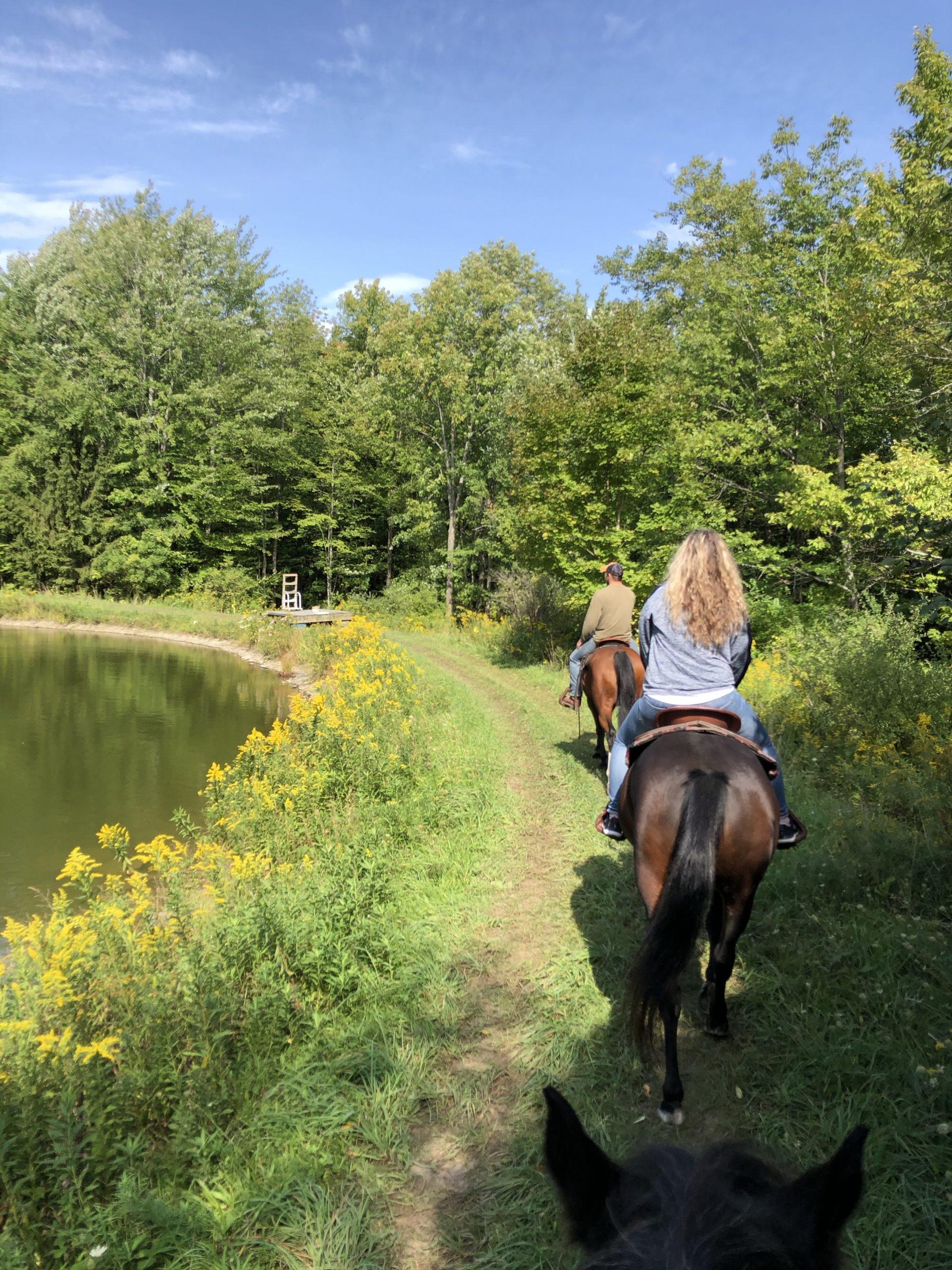 Horseback Riding Around a Pond