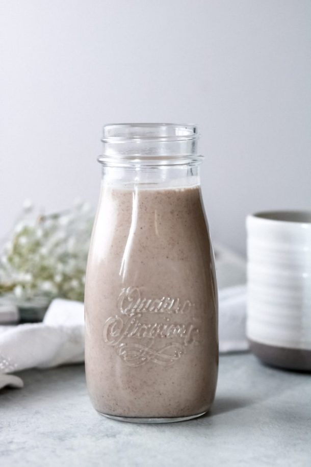 a jar of dairy-free cinnamon roll coffee creamer