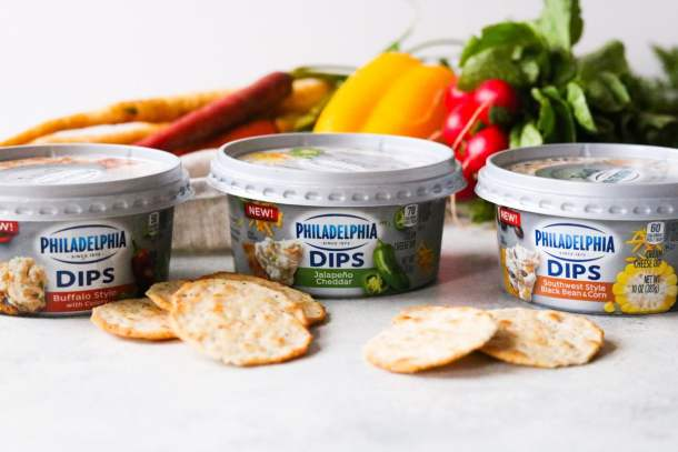 three containers of the NEW PHILADELPHIA Dips with fresh vegetables and crackers