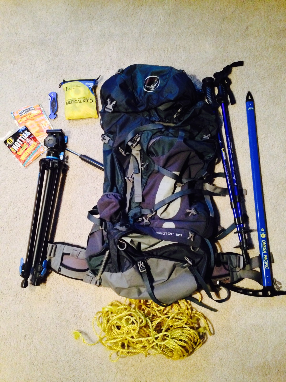 Osprey Aether 85L backpack, camera tri-pod, Omega Pacific 80cm ice axe, Mountainsmith trekking poles, paracord, med-kit, knife, hand warmers