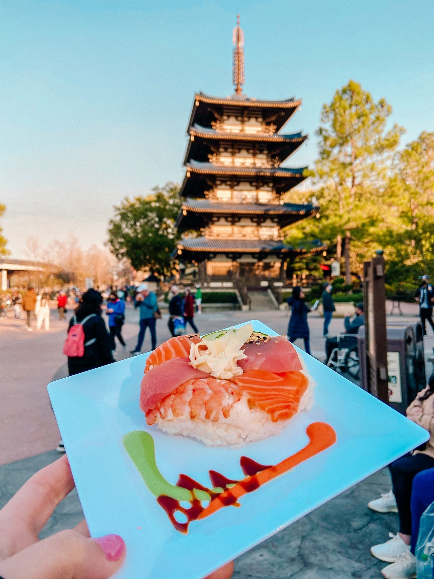 Sushi donut with raw fish on top of rice in the shape of a donut at Japan in Orlando Florida Disney World Epcot Theme Park