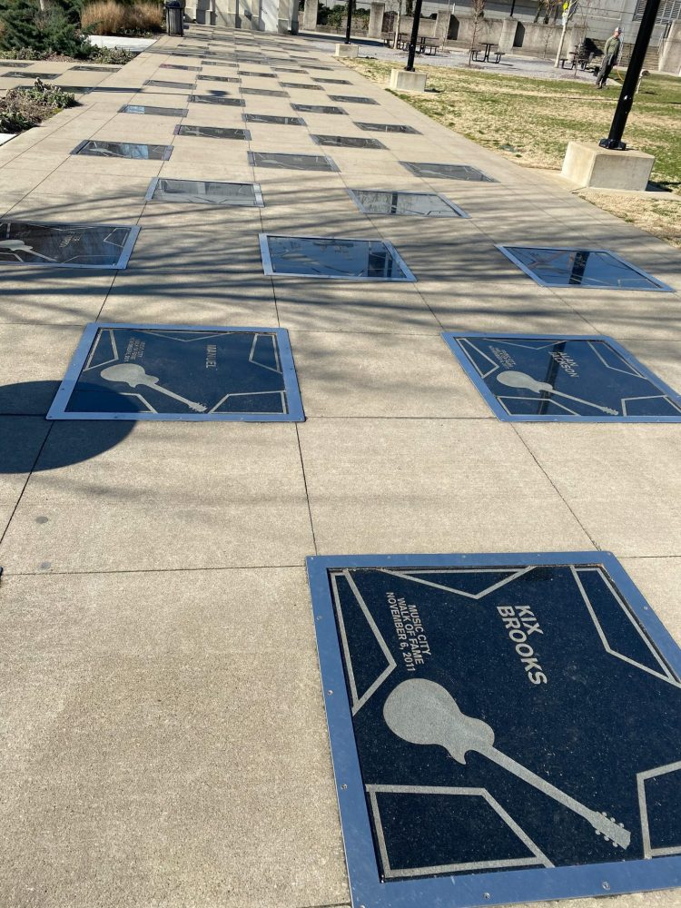 Walk of Fame in the pavement recognizing country music legends.