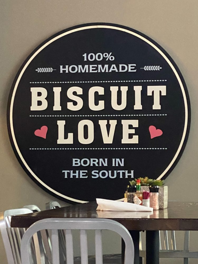 logo stating 100% homemade biscuit love born in the south
