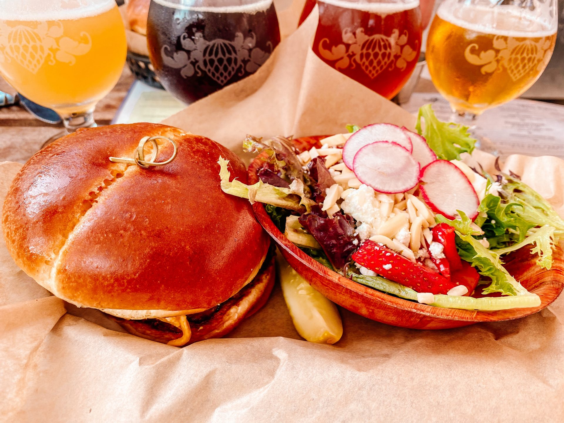 wicked weed brewery beer flight and a burger and side salad in asheville north carolina