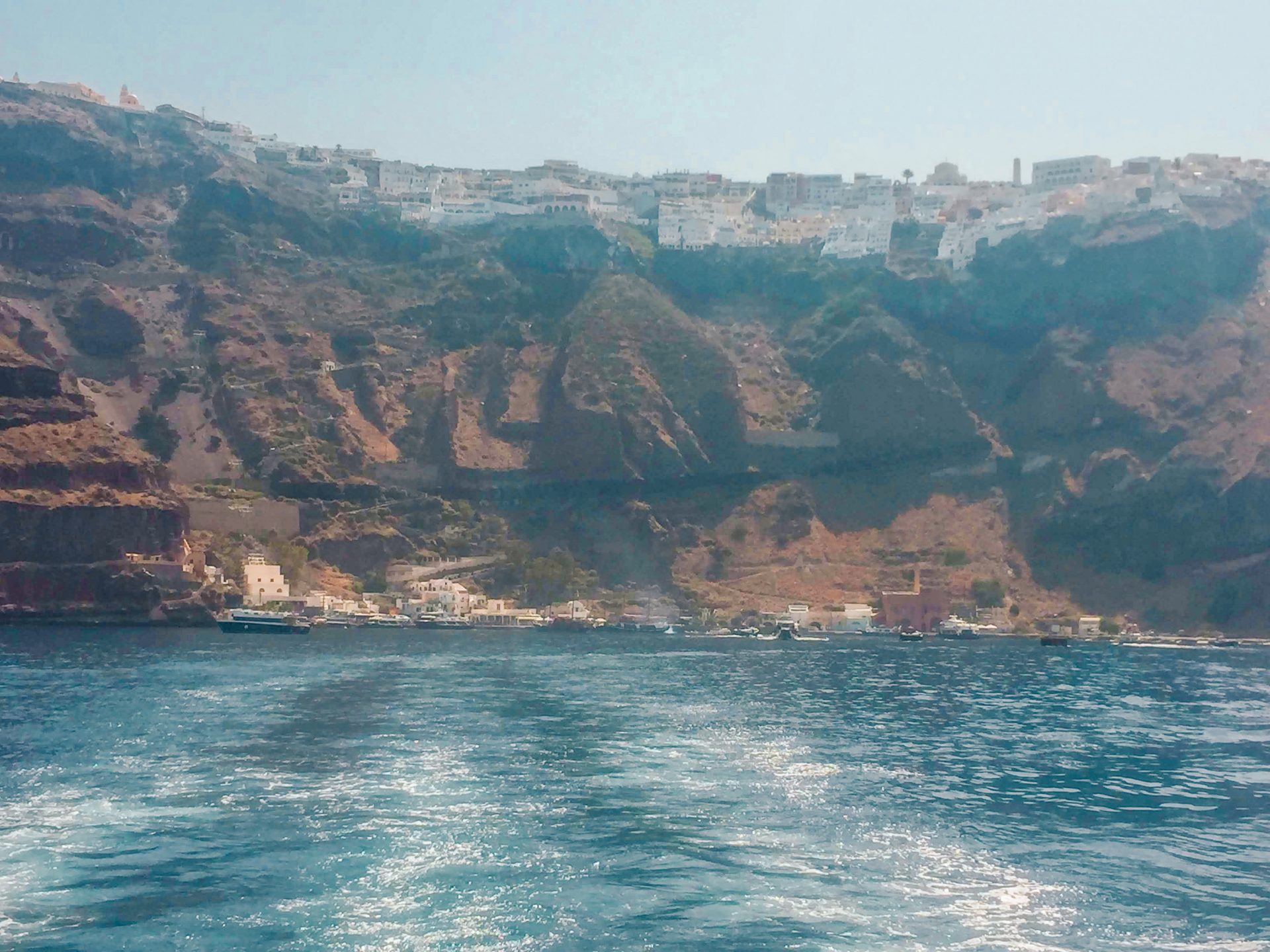 the view of Oia from Thirassia Greece