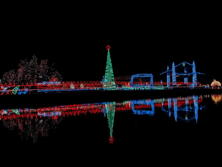 The Christmas lights from Bentleyville shimmering off of Lake Superior. Photo taken from Pier B Resort.
