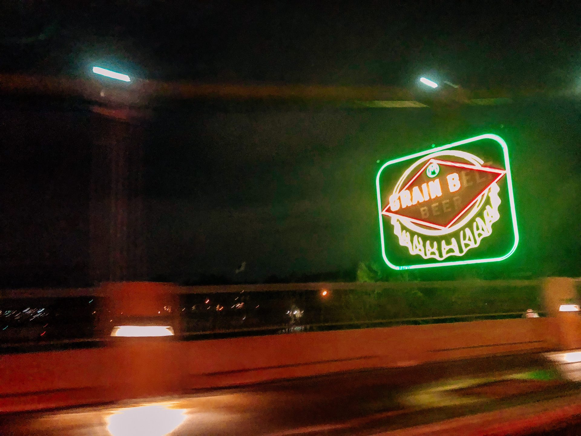 Grain belt sign lit up at night in minneapolis mn downtown on the hennepin suspension bridge