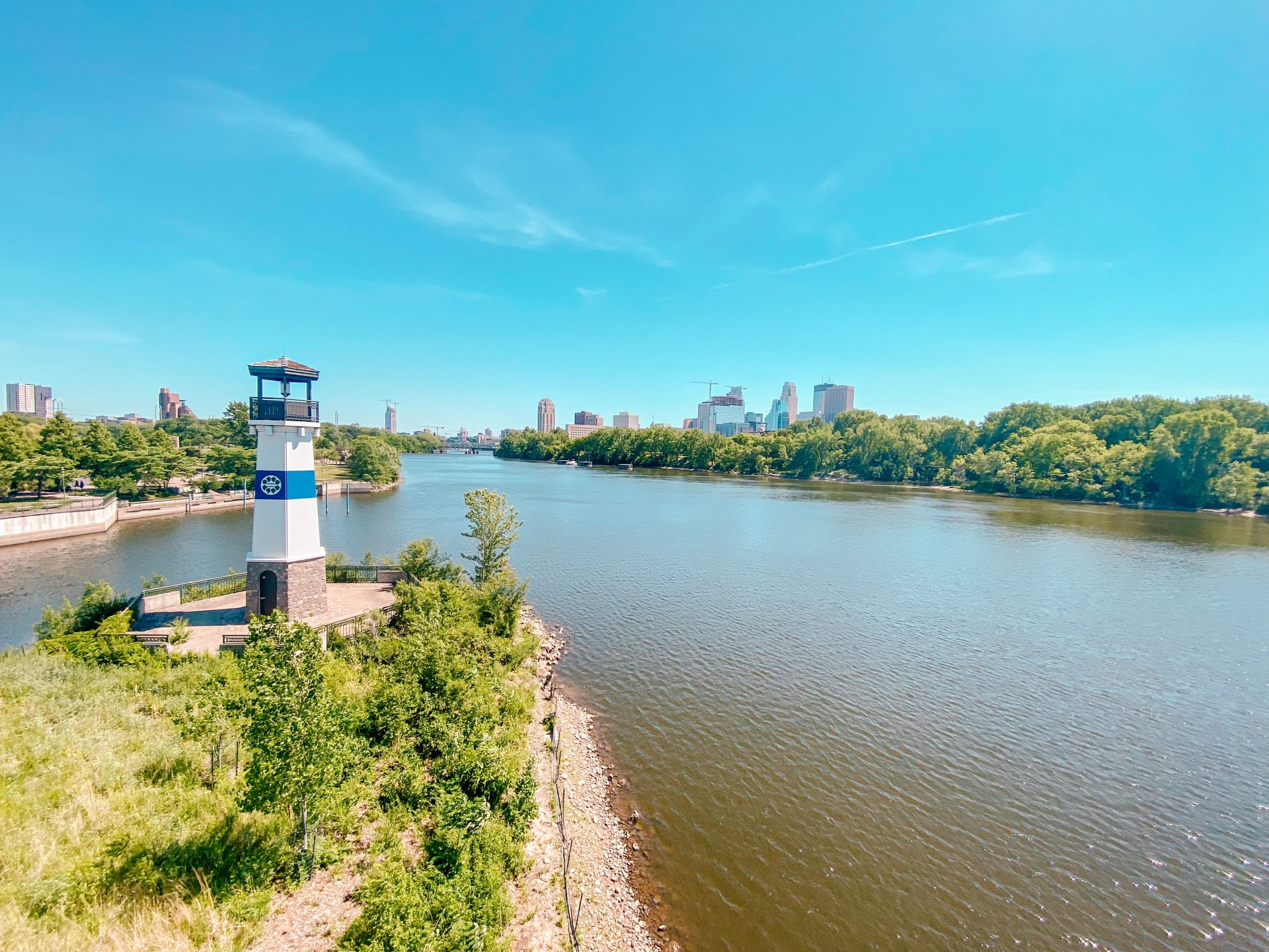 View from Plymouth Avenue Bridge to Boom Island Park lighthouse and Mississippi River in Minneapolis, Minnesota