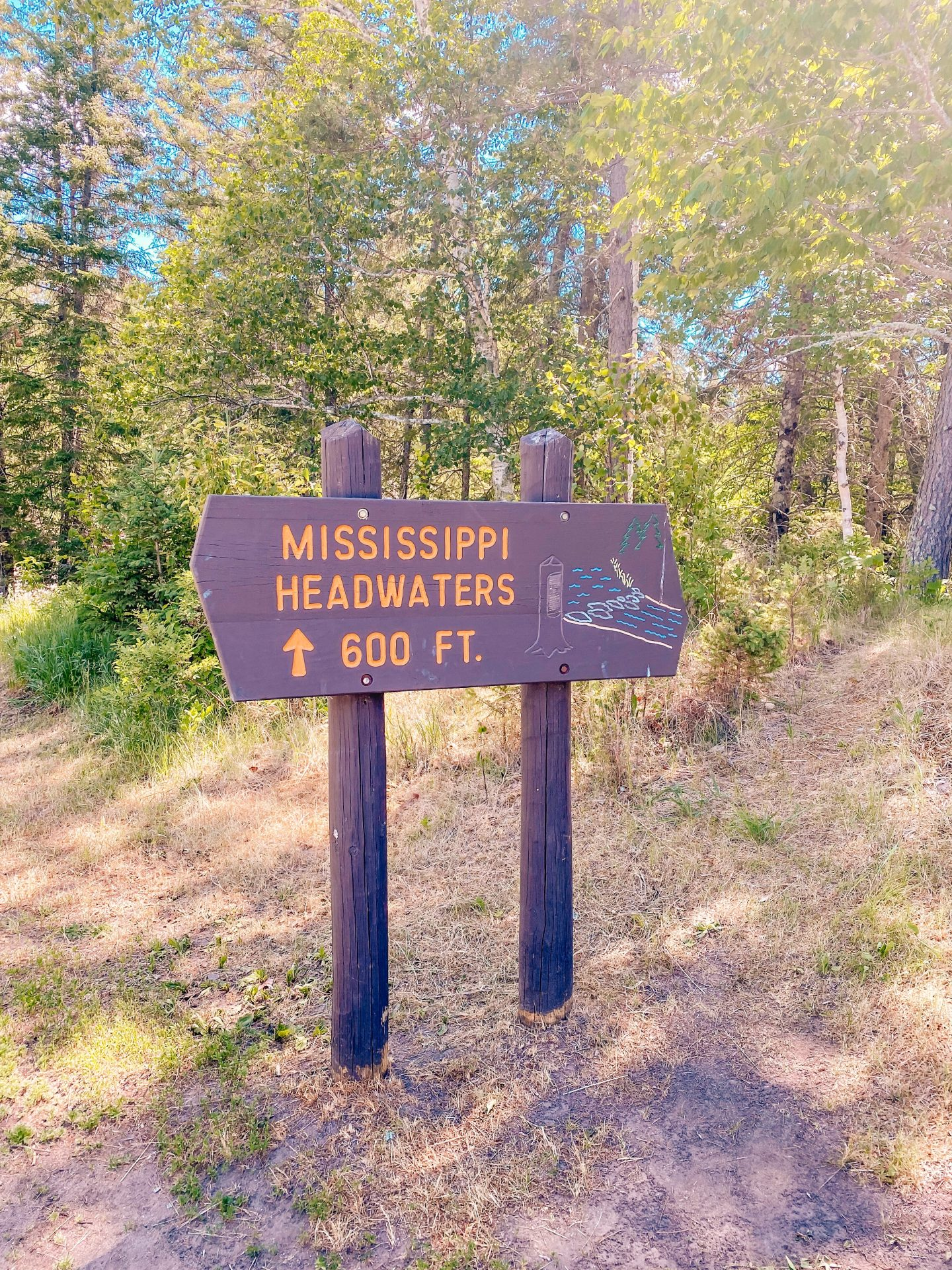 Sign along the path to the Mississippi headwaters in Minnesota at Itasca State Park