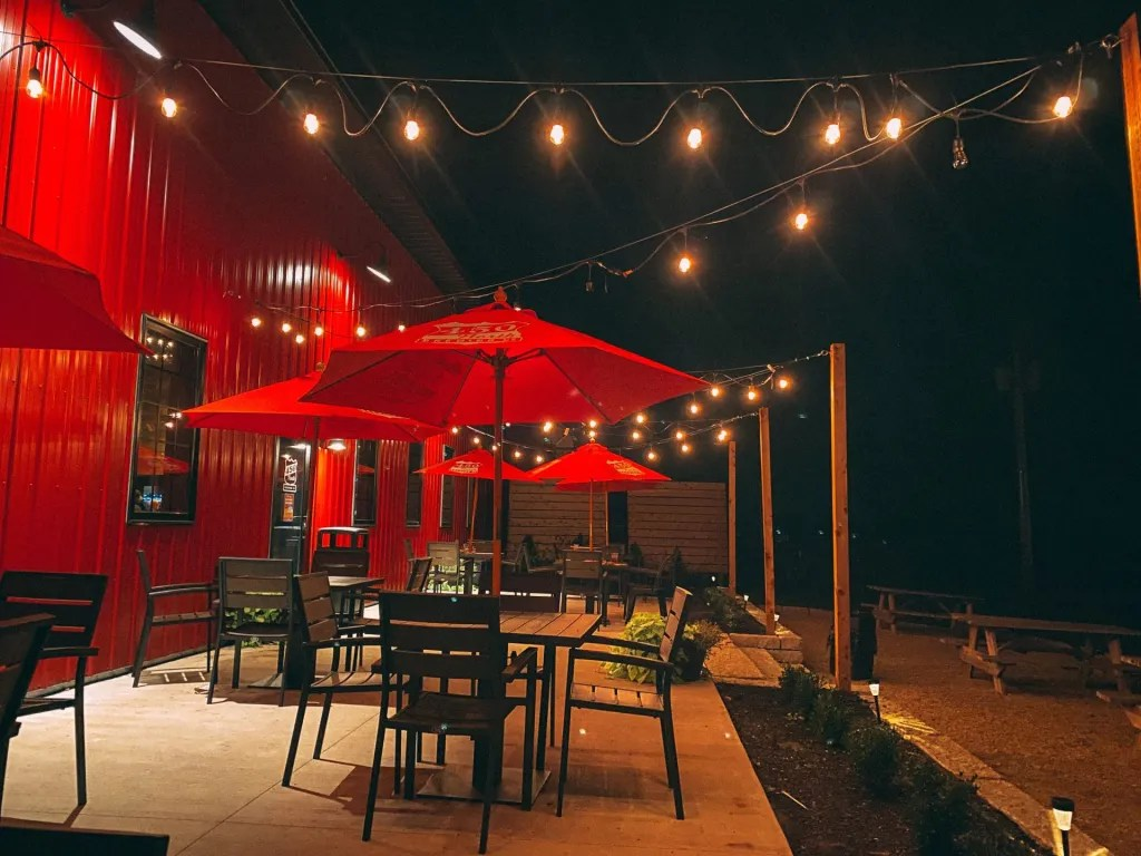 Closing down the patio at 450 N brewery at night with the lights lit up and the rest of the tables empty