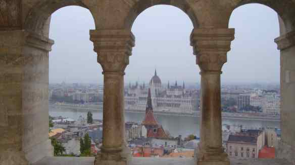 view of Budapest parliament, through the columns of Fisherman's Bastion