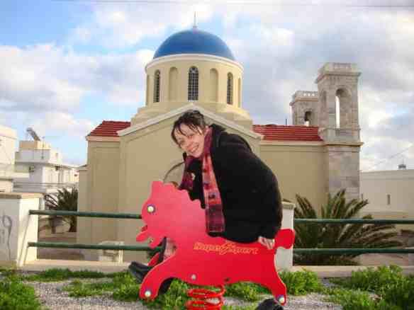 Playground in front of a Greek orthodox church in Syros, best Greek Cyclades island