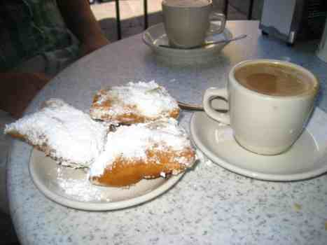 Beignets and café au lait at the famous Cafe Du Monde. New Orleans.