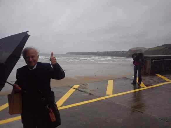 Despite Dad's umbrella nearly blowing away in horrid conditions, he still manages a thumbs up at the foot of the Copper Coast in Tramore.