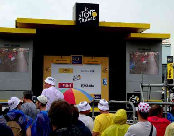 The famous Tour de France podium, where the stage winner receives his winning jersey and gets his double sided cheek kisses from two models.