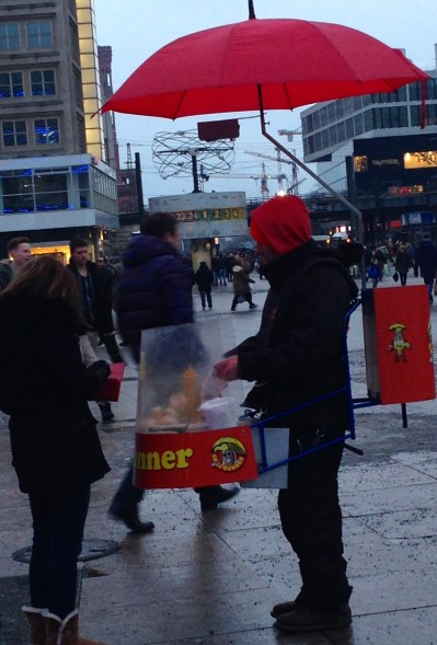 This man is a Grillrunner. Many of these mobile Wurst vendors can be found around Alexanderplatz. They sell different types of sausages for only 1.50 Euro.
